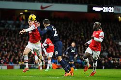Man Utd Forward Robin van Persie (NED) heads a shot past Arsenal Defender Per Mertesacker (GER) but is denied by Goalkeeper Wojciech Szczesny (POL) (not pictured) - Photo mandatory by-line: Rogan Thomson/JMP - 07966 386802 - 12/02/14 - SPORT - FOOTBALL - Emirates Stadium, London - Arsenal v Manchester United - Barclays Premier League.