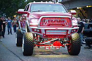 Bellmore, New York, USA. August 11, 2017. Red RAM lifted underlit truck drives past onlookers at the Bellmore Friday Night Car Show