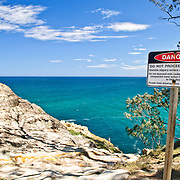 Danger signs on the top of the cliffs at Point Lookout on Stadbroke Island, Queensland North Stradbroke Island, just off Queensland's capital city of Brisbane, is the world's second largest sand island and, with its miles of sandy beaches, a popular summer holiday destination.