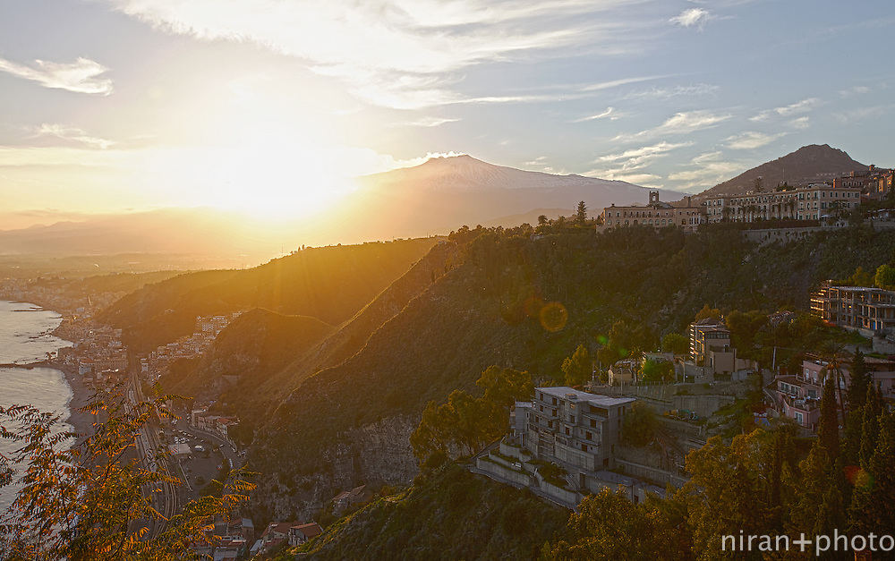 Taormina at sunset with Mount Etna as a backdrop