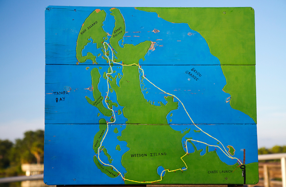 A wooden map showcases the paddling trail from the kayak/canoe launch at Weedon Island Preserve. Nestled between the thriving cities of Tampa and St. Petersburg, Weedon Island Preserve offers a fun and easy daytrip for fishing, hiking and paddling. 2 mile and 4 mile paddling trails meander through mangrove tunnels, over seagrass flats and around mangrove islands. The preserve also offers ample wildlife viewing on hiking trails and from an observation tower. .Photo by James Branaman