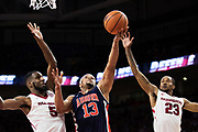 FAYETTEVILLE, AR - FEBRUARY 27:  Desean Murray #13 of the Auburn Tigers goes in for a shot past C.J. Jones #23 and Arlando Cook #5 of the Arkansas Razorbacks at Bud Walton Arena on February 27, 2018 in Fayetteville, Arkansas.  The Razorbacks defeated the Tigers 91-82.  (Photo by Wesley Hitt/Getty Images) *** Local Caption *** Desean Murray; Arlando Cook; C.J. Jones