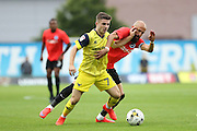 Oxford United's Dan Crowley and Brighton & Hove Albion's Bruno Saltor (Captain) during the Pre-Season Friendly match between Oxford United and Brighton and Hove Albion at the Kassam Stadium, Oxford, England on 26 July 2016.