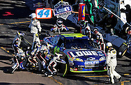 Nov. 15, 2009; Avondale, AZ, USA; NASCAR Sprint Cup Series driver Jimmie Johnson pits during the Checker O'Reilly Auto Parts 500 at Phoenix International Raceway. Mandatory Credit: Jennifer Stewart-US PRESSWIRE