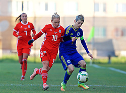 ZENICA, BOSNIA AND HERZEGOVINA - Tuesday, November 28, 2017: Wales' Jessica Fishlock and Bosnia and Herzegovina's captain Amira Spahić during the FIFA Women's World Cup 2019 Qualifying Round Group 1 match between Bosnia and Herzegovina and Wales at the FF BH Football Training Centre. (Pic by David Rawcliffe/Propaganda)