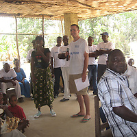 Ben Kirley Volunteer Work in Sierra Leone.....30.07.12<br /> Ben Kirley speaking at local meeting, alongside S.L. colleague Henrietta Sellu<br /> Picture by Graeme Hart.<br /> Copyright Perthshire Picture Agency<br /> Tel: 01738 623350  Mobile: 07990 594431