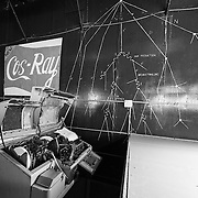 Wall mural of cosmic rays, and the old teletype machine used for recording/transmitting data.<br />