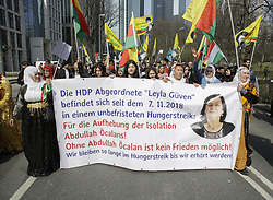 """March 23, 2019 - Frankfurt, Hesse, Germany - Kurdish women carry a banner about the HDP Turkish MP, who is on hunger strike for the freedom of Abdullah Ocalan. Several thousand Kurds marched through Frankfurt, to celebrate Nawroz, the Kurdish New Year's festival. It was the central celebration for Germany and was held under the motto """"Free Abdullah Ocalan"""", the leader of the PKK  (Credit Image: © Michael Debets/Pacific Press via ZUMA Wire)"""
