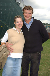 JACK KIDD and his wife BE at the Veuve Clicquot sponsored Gold Cup or the British Open Polo Championship won by The  Azzura polo team who beat The Dubai polo team 17-9 at Cowdray Park, West Sussex on 18th July 2004.