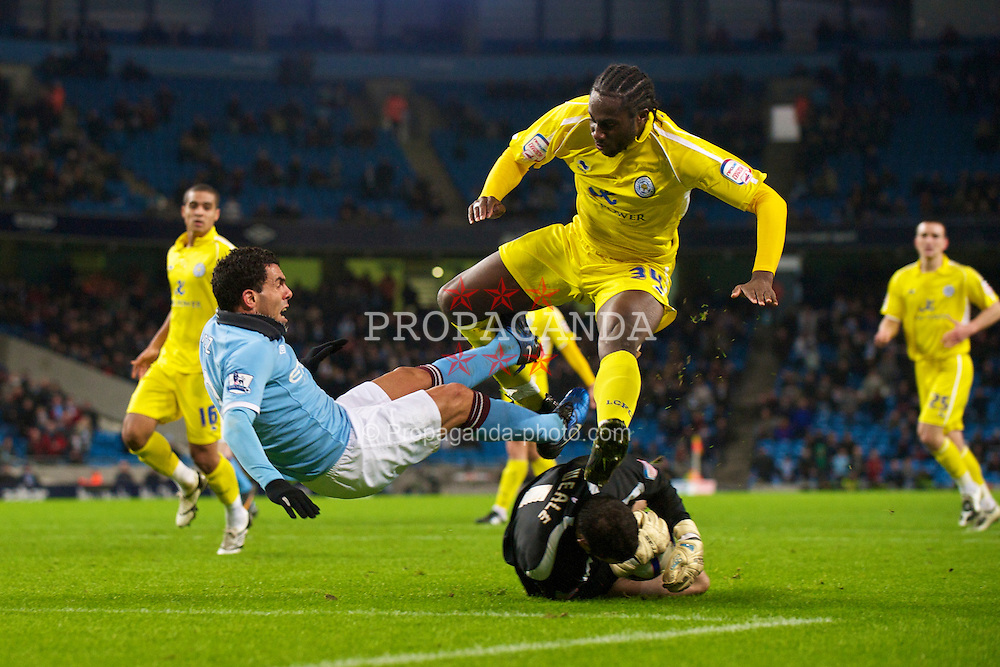 MANCHESTER, ENGLAND - Tuesday, January 18, 2011: Manchester City's Carlos Tevez and Leicester City's goalkeeper Chris Weale and Souleymane Bamba during the FA Cup 3rd Round Replay match at the City of Manchester Stadium. (Photo by David Rawcliffe/Propaganda)