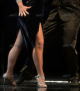 The Colombian couple of Ana Zoraida Gomez Diaz(L) and Jorge Andres Padilla Mayo dance during the semifinal round of the Stage Tango competition at the Tango Dance World Championship in Buenos Aires on August 25, 2012.   AFP PHOTO / Alejandro PAGNI