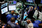 Trouble on Wall Street.Floor specialists at the NYSE New York Stock Exchange reacting to the announcement that the interest rate remains unchanged.