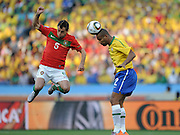 DUDA (Portugal) and MAICON (Brazil) jump for the ball during the 2010 FIFA World Cup South Africa Group G match between Portugal and Brazil at Durban Stadium on June 25, 2010 in Durban, South Africa.