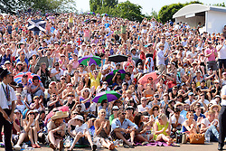 © London News Pictures. 07/07/2013 . London, UK. Crowds gather in a viewing area known as 'Murray Mound' to watch as Andy Murray and Novak Djokovic of Serbia compete in the final of the Wimbledon Lawn Tennis Championships. Andy Murray won the match becoming the first British male to win the tournament in 77 years. Photo credit: Mike King/LNP