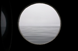 USA ALASKA  BERLING SEA 6JUL12 - View out of a porthole aboard the Greenpeace ship Esperanza looking to the unusually calm waters of the Bering Sea, Alaska.....Photo by Jiri Rezac / Greenpeace....© Jiri Rezac / Greenpeace