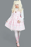 Full length of young woman dressed as a doll over gray background
