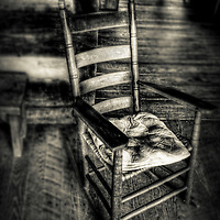An old rocking chair with a cushion