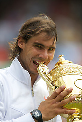 LONDON, ENGLAND - Sunday, July 4th, 2010: Rafael Nadal (ESP) celebrates his 6-3, 7-5, 6-4 Gentlemen's Singles Final victory by biting the trophy on day thirteen of the Wimbledon Lawn Tennis Championships at the All England Lawn Tennis and Croquet Club. (Pic by David Rawcliffe/Propaganda)