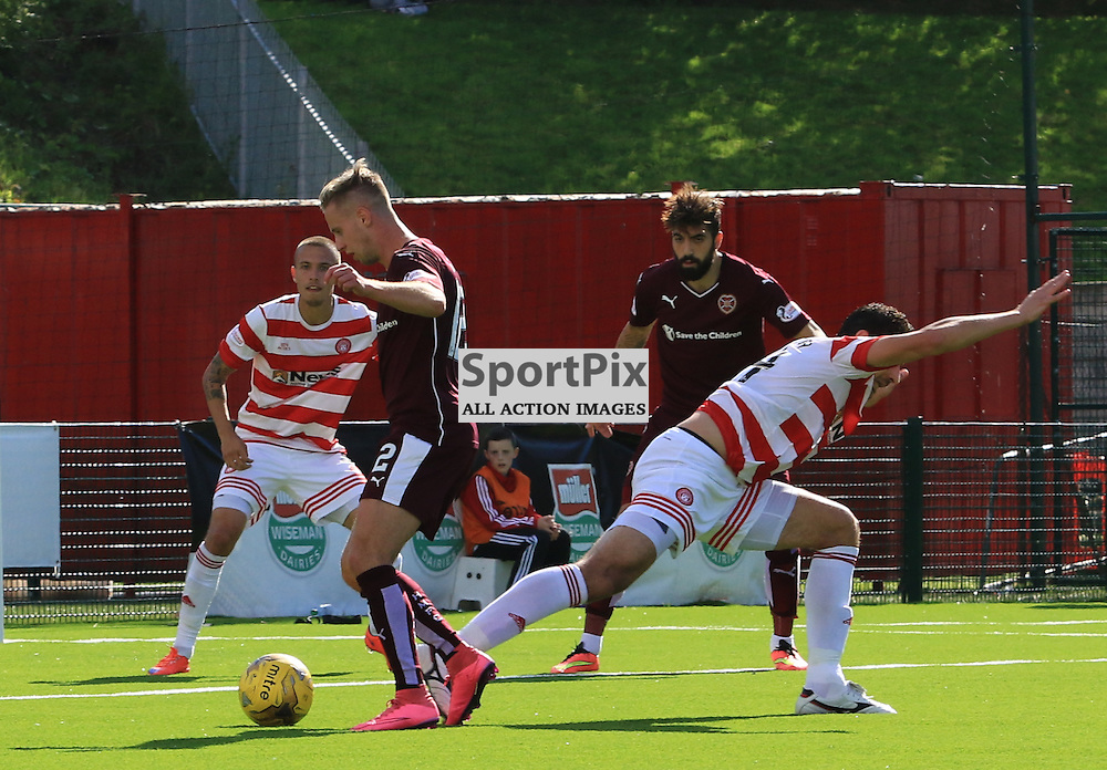 Billy King rounds the defender before scoring the equalising goal during the Hamilton Academical FC  V Heart of Midlothian FC Scottish Premiership 29th August 2015  ©Edward Linton | SportPix.org.uk