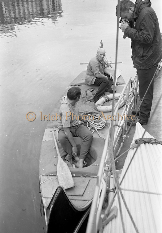 03/08/1967<br /> 08/03/1967<br /> 03 August 1967<br /> Arrival of &quot;Saint Brendan II&quot; in Dublin. Image shows Captain Louis Lourmais (rear) and Vint Lloyd of Nova Scotia, on board the &quot;Saint Brendan II&quot; a curragh they hoped to sail from Fenit Co. Kerry to America by the Northern Route (Ireland, Iceland, Greenland, North America) and land between Boston and Rhode Island to see if Brendan the Navigator could have reached North America in the 6th century AD. Captain Lourmais had the curragh built to specifications resembling those of what was believed to be the type of craft available in the  6th century. It was the first time the curragh had been in the water since its construction.