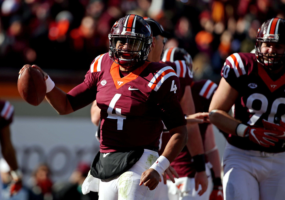 Nov 26, 2016; Blacksburg, VA, USA;  Virginia Tech Hokies quarterback Jerod Evans (4) reacts after a touchdown during the second quarter at Lane Stadium. Mandatory Credit: Peter Casey-USA TODAY Sports