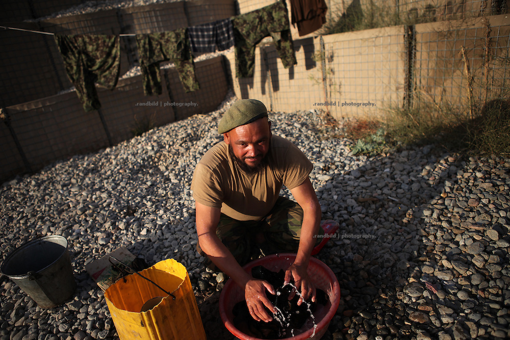 A soldier of Afghan National Army washes clothes in Combat Outpost Qualtiam, northern Afghanistan.