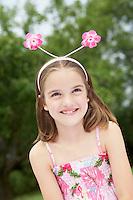 Girl in backyard Wearing Floral Deely Boppers portrait