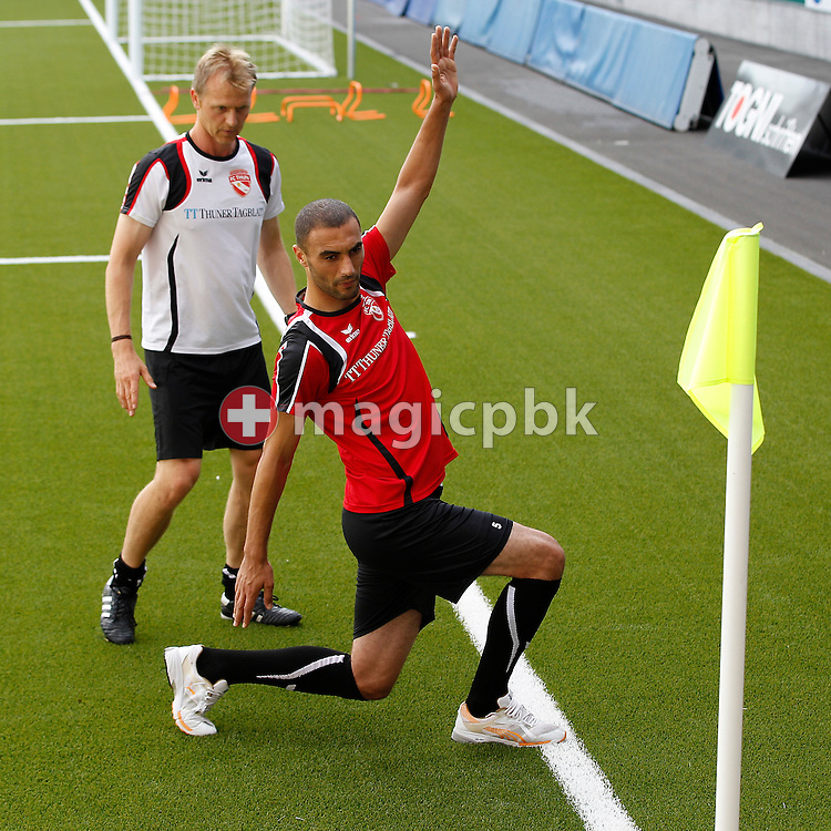 FC Thun defender Saif GHEZAL of Tunis is pictured during a fitness test with assistant coach and strength and conditioning assistant Pi Zuercher (L) at the Arena Thun in Thun, Switzerland, Friday, Aug. 19, 2011. (Photo by Patrick B. Kraemer / MAGICPBK)
