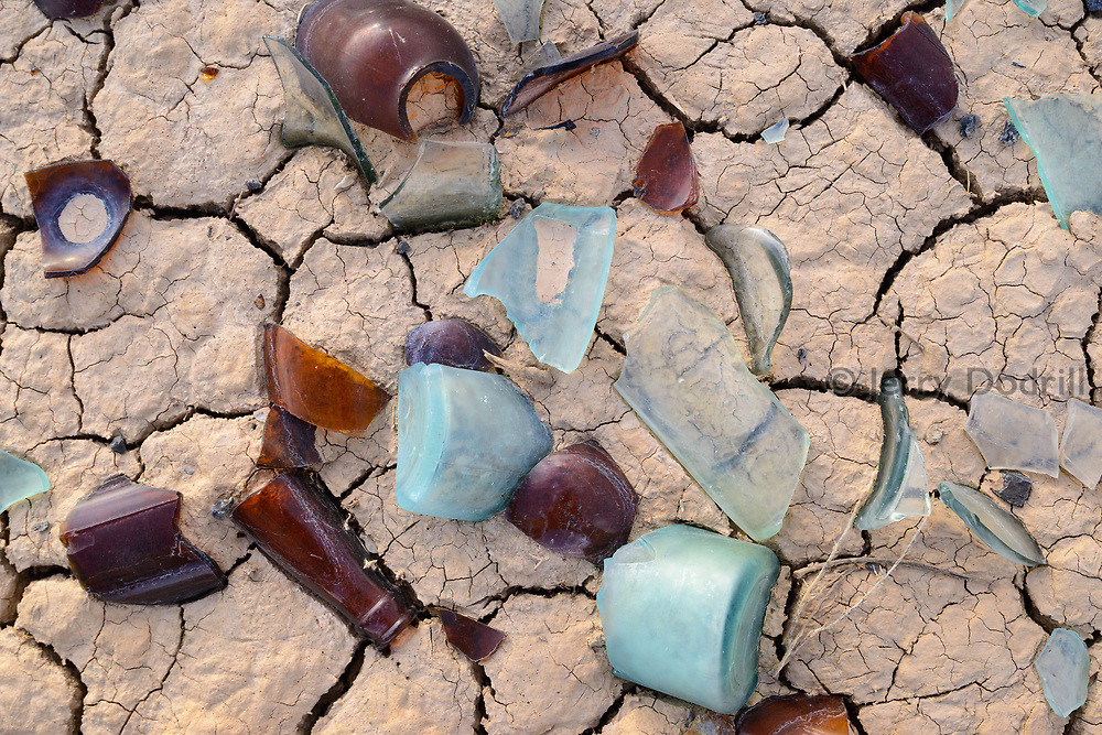 Shards of glass bottles left behind by miners in the 1880's outside the rural town of Mina in Western Nevada.
