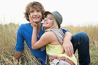 Happy loving couple relaxing in field