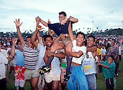 Darren Kellett of Manu Samoa is hoisted onto the shoulders of his fans after a Super 10 rugby union match, 1993. Photo: Andrew Cornaga / www.photosport.co.nz