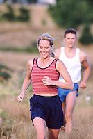 Couple jogging --- Image by © Jim Cummins/CORBIS