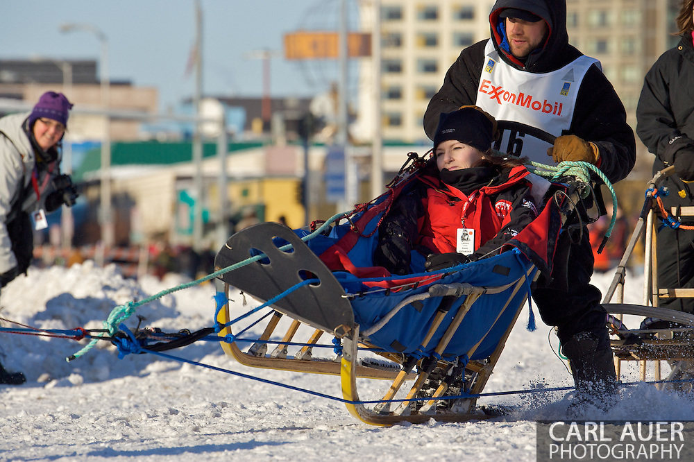 March 7th, 2009:  Anchorage, Alaska - Ramey Smyth of Willow, Alaska brings his sled up onto one rail as he takes the first corner off of 4th Avenue at the start of the 2009 Iditarod Sled Dog Race.