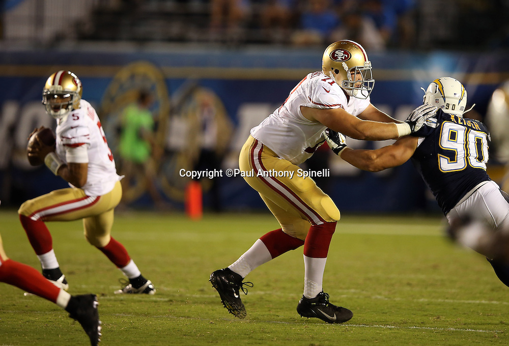 San Francisco 49ers offensive tackle Carter Bykowski (71) pass blocks San Diego Chargers linebacker Thomas Keiser (90) during the NFL week 4 preseason football game against the San Diego Chargers on Thursday, Aug. 29, 2013 in San Diego. The 49ers won the game 41-6. ©Paul Anthony Spinelli