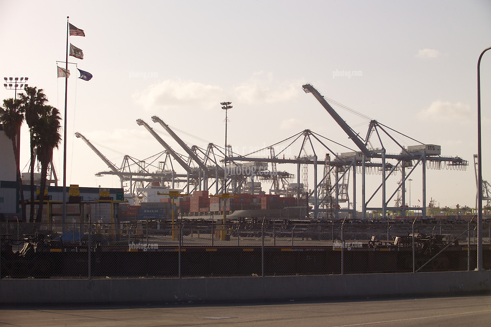 Operations, Ship, Flags & Golden Sky. The Port of Long Beach at Sunset. Cranes and Shipping.