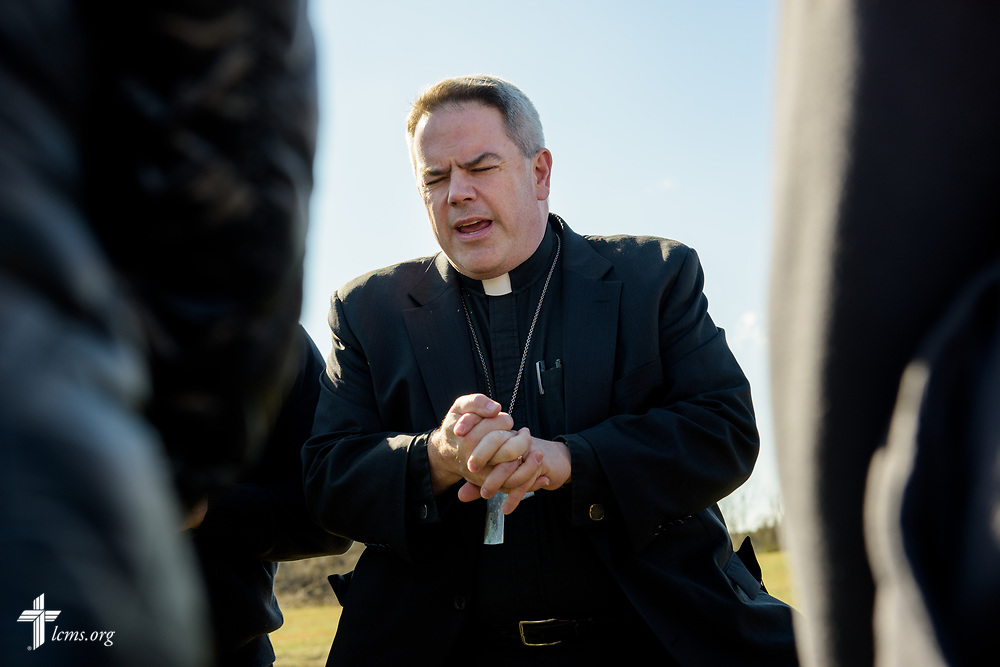 The Rev. Lee Hagan, LCMS Missouri District president, prays with victims of a tornado on Wednesday, March 1, 2017, in Perryville, Mo.LCMS Communications/Erik M. Lunsford