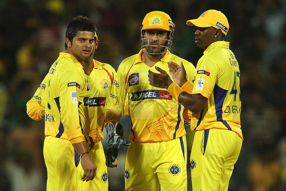 Suresh raina, MS Dhoni and Dwayne Bravo during match 3 of the NOKIA Champions League T20 ( CLT20 )between the Chennai Superkings and the Mumbai Indians held at the M. A. Chidambaram Stadium in Chennai , Tamil Nadu, India on the 24th September 2011..Photo by Sundar Raman/BCCI/SPORTZPICS