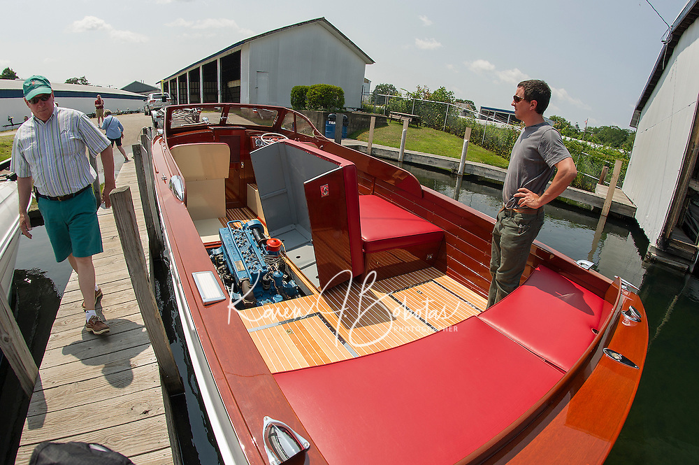 Gary and Seth Kiedaisch launch their 1952 27' Chris Craft cruiser into Paugus Bay at Irwin Marine Friday afternoon.  The Kiedaisch's have fully restored this semi enclosed cruiser over the past two years.   (Karen Bobotas/for the Laconia Daily Sun)