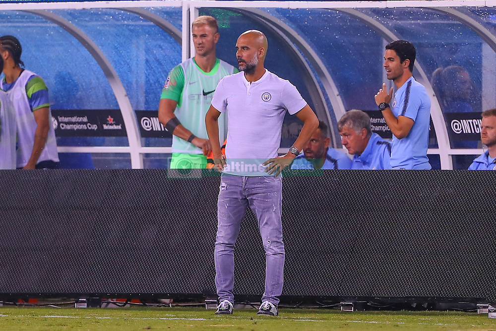 July 25, 2018 - East Rutherford, NJ, U.S. - EAST RUTHERFORD, NJ - JULY 25:  Manchester City head coach Pep Guardiola during halftime of the International Champions Cup Soccer game between Liverpool and Manchester City on July 25, 2018 at Met Life Stadium in East Rutherford, NJ.  (Photo by Rich Graessle/Icon Sportswire) (Credit Image: © Rich Graessle/Icon SMI via ZUMA Press)