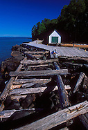 A sea kayaker reads and relaxes on the remains of a dock and boathouse on Devils Island in Apostle Islands National Lakeshore near Bayfield, Wis.