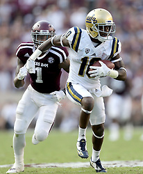 UCLA wide receiver Kenneth Walker III (10) catches a pass then evades Texas A&M Nick Harvey (1) for a 62 yard catch and run touchdown during the fourth quarter of an NCAA college football game against Saturday, Sept. 3, 2016, in College Station, Texas. Texas A&M won 31-24 in overtime. (AP Photo/Sam Craft)
