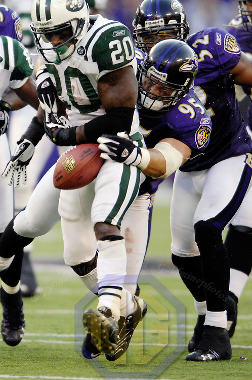 16 September 2007:  New York Jets running back Thomas Jones (20) runs for a 9 yard gain in the 4th quarter before fumbling on a hit by Baltimore Ravens defensive end Jarret Johnson (95).  The fumble was recovered by New York Jets guard Adrien Clarke as the Ravens defeated the Jets 20-13 at M&T Bank Stadium in Baltimore, Md. .