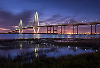 Dusk reflections at the Arthur Ravenel Jr. Bridge over the Cooper River in Charleston, South Carolina.  The bridge connects downtown Charleston to nearby Mount Pleasant, South Carolina.