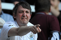Newcastle United fan cuts a frustrated figure - Photo mandatory by-line: Dougie Allward/JMP - Mobile: 07966 386802 - 16/05/2015 - SPORT - football - London - Loftus Road - QPR v Newcastle United - Barclays Premier League