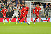 Bayern Munich midfielder Philippe Coutinho (10) tries to evade Tottenham Hotspur forward Harry Kane (10) during the Champions League match between Tottenham Hotspur and Bayern Munich at Tottenham Hotspur Stadium, London, United Kingdom on 1 October 2019.