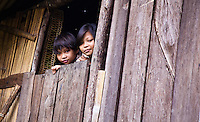 These Penan kids were doing their homework as they waited for their parents to return from the jungle.   The Penan traditionally are nomads of the jungle and many have not been able to fully acclimatise to living in towns.