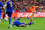 AMSTERDAM, Nederland - Kazachstan, voetbal, interland, oranje, kwalificatie EK 2016, 15-10-2014, Stadion de Arena, Nederland speler Ibrahim Afellay (R) scoort de 2-1, Kazachstan speler Dmitri Shomko (M).