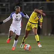 Crystal Dunn, USA, dribbles past Liana Salazar, (right), Colombia, during the USA Vs Colombia, Women's International friendly football match at the Pratt & Whitney Stadium, East Hartford, Connecticut, USA. 6th April 2016. Photo Tim Clayton
