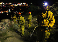 Firefighters respond to a grassfire at Tablerock on Monday night at about 11:30pm that blackened the area in front of the cross before crews were able to extinguish the flames.