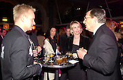Sting, Trudie Styler and Gerald Ronson, Fundraising party with airline theme in aid of the Old Vic and to celebrate the appointment of Kevin Spacey as artistic director.  <br />Old Billinsgate Market.  5 February 2003. © Copyright Photograph by Dafydd Jones 66 Stockwell Park Rd. London SW9 0DA Tel 020 7733 0108 www.dafjones.com